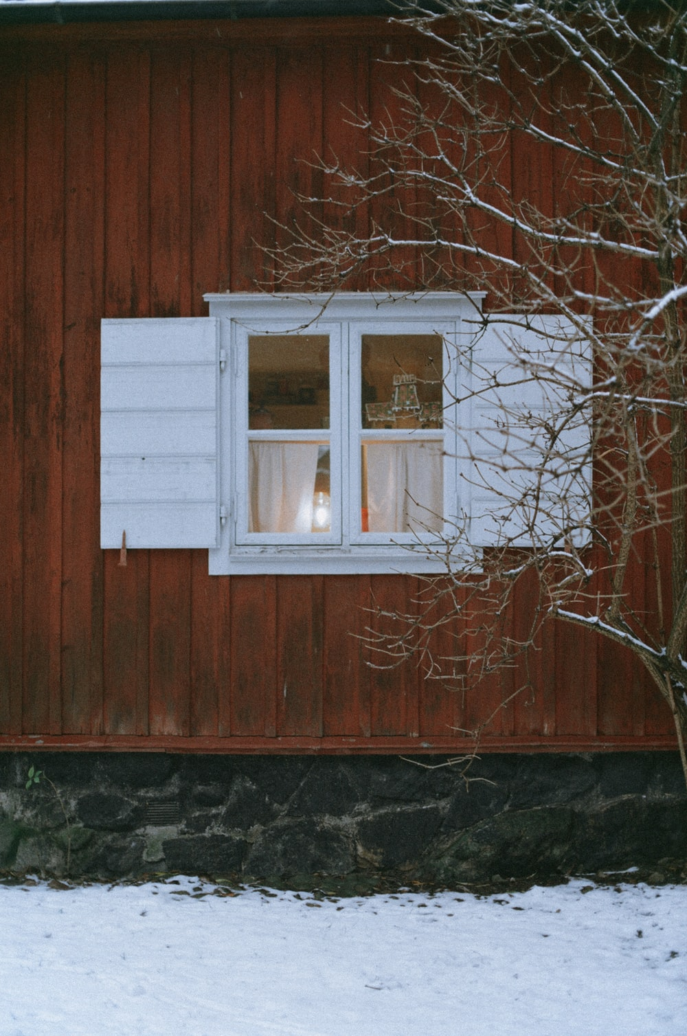 white wooden window frame on brown wooden wall