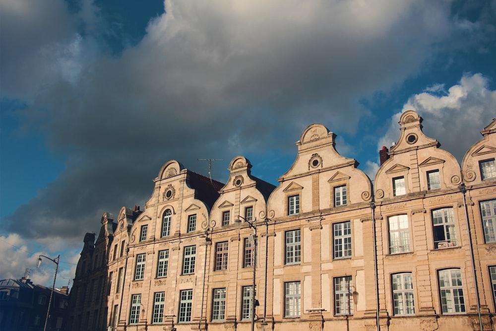 beige concrete building under blue sky