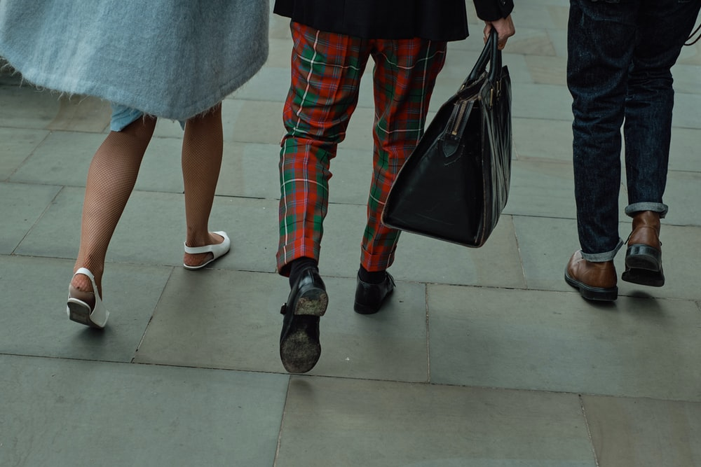 woman in red and black plaid pants and red shoes