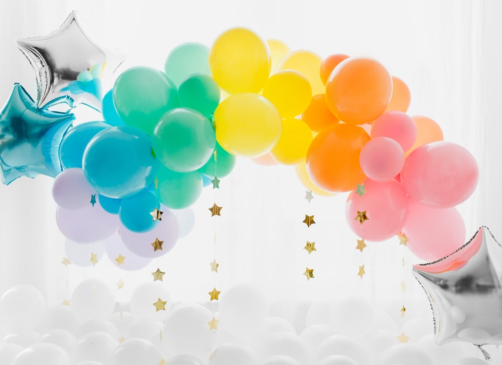 blue and yellow balloons with white clouds