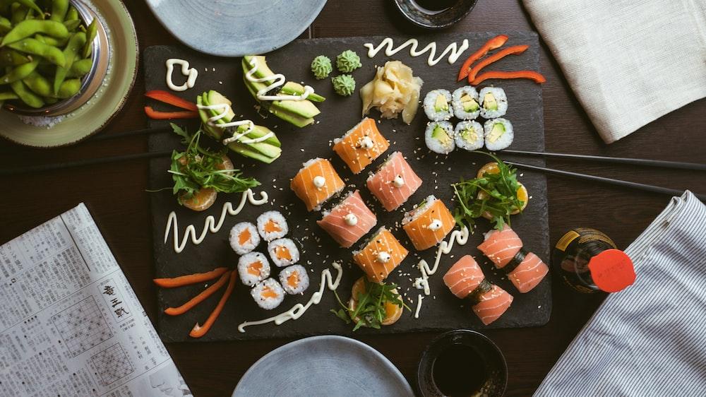 sushi on black ceramic plate