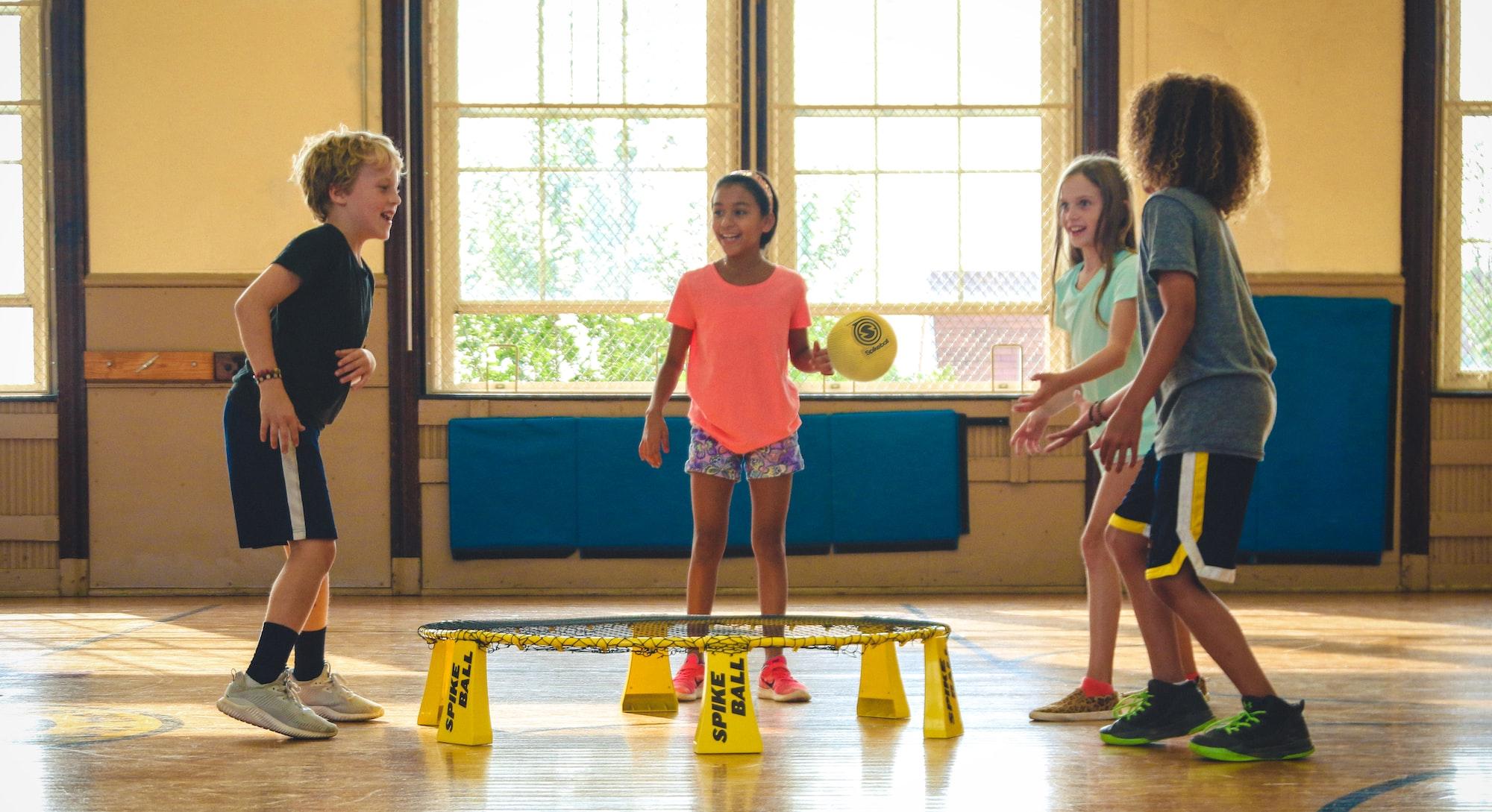 Kids playing Spikeball on a Spikeball Rookie Kit