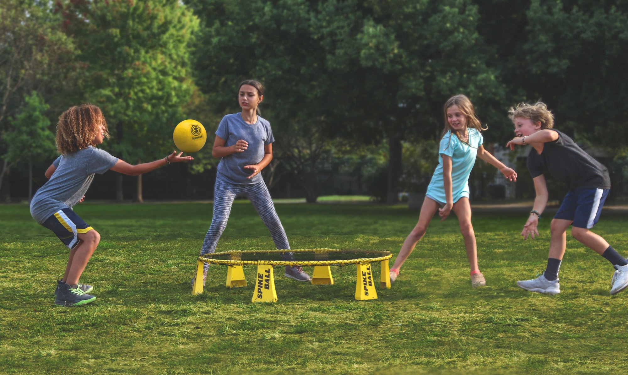 Kids playing Spikeball on the Spikeball Rookie Kit