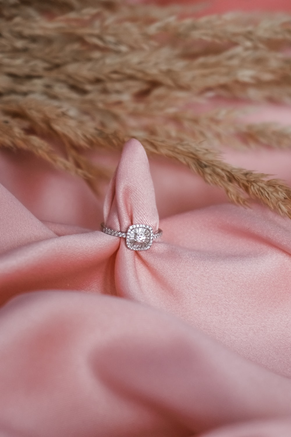pink textile with silver diamond ring