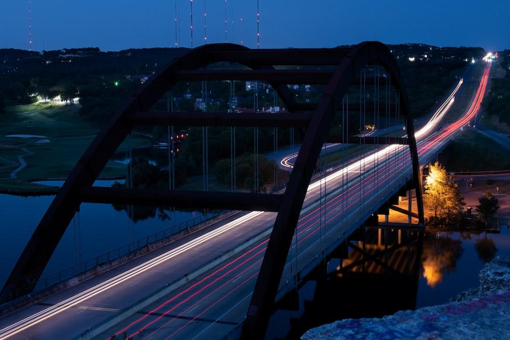 gray metal bridge over river during daytime