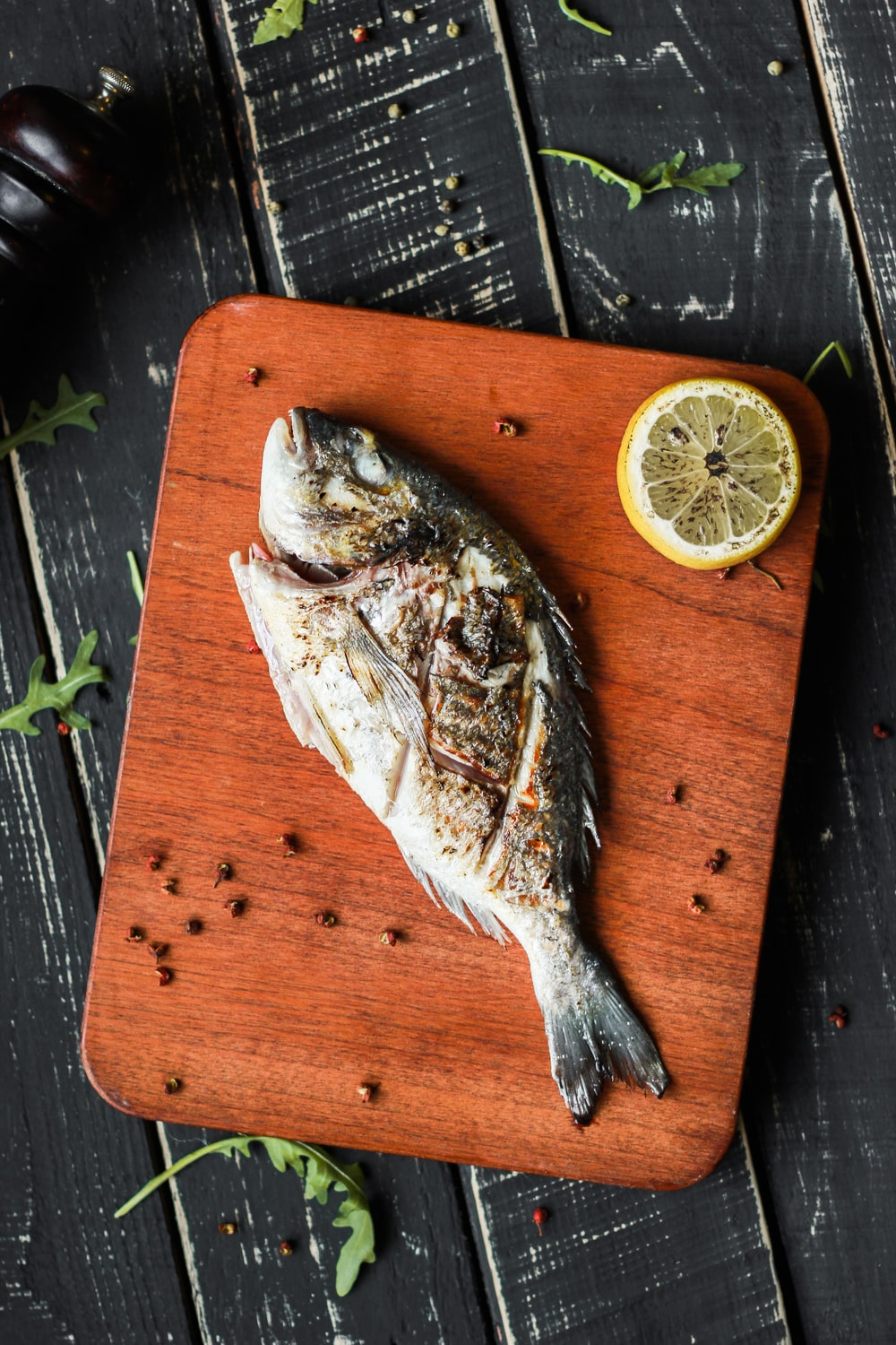 fish on brown wooden chopping board