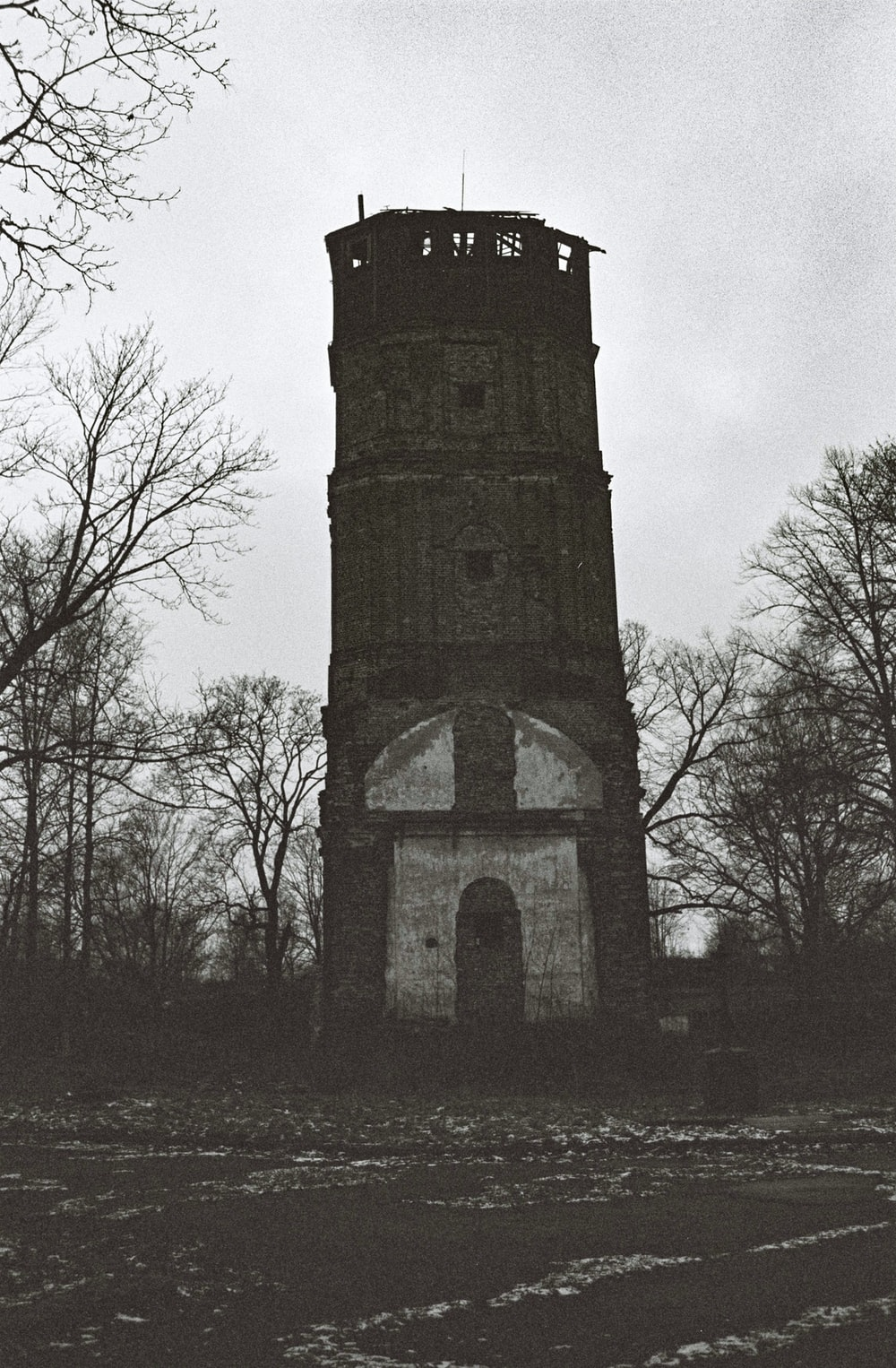 black and white tower under gray sky
