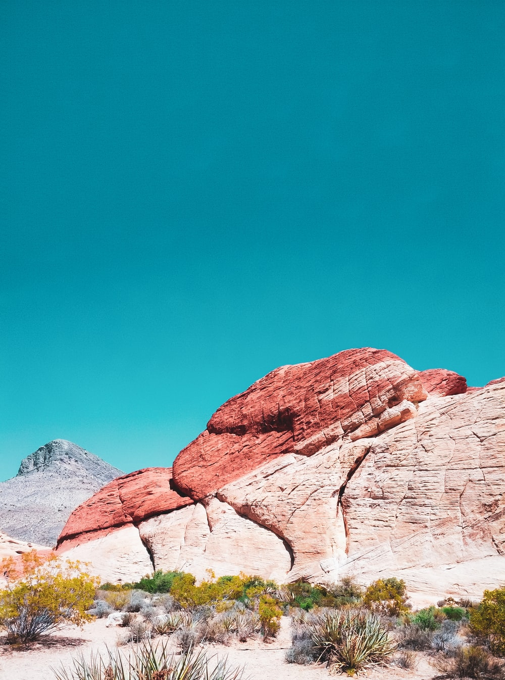 brown rocky mountain under blue sky during daytime