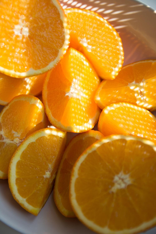 close up photo of sliced orange fruits