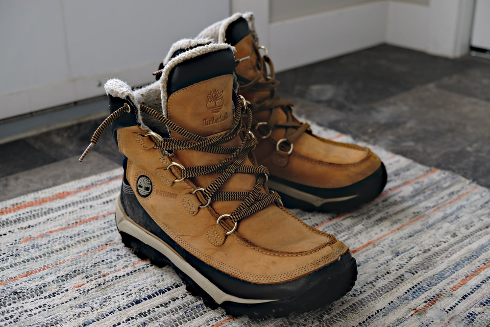 brown and black high top sneakers
