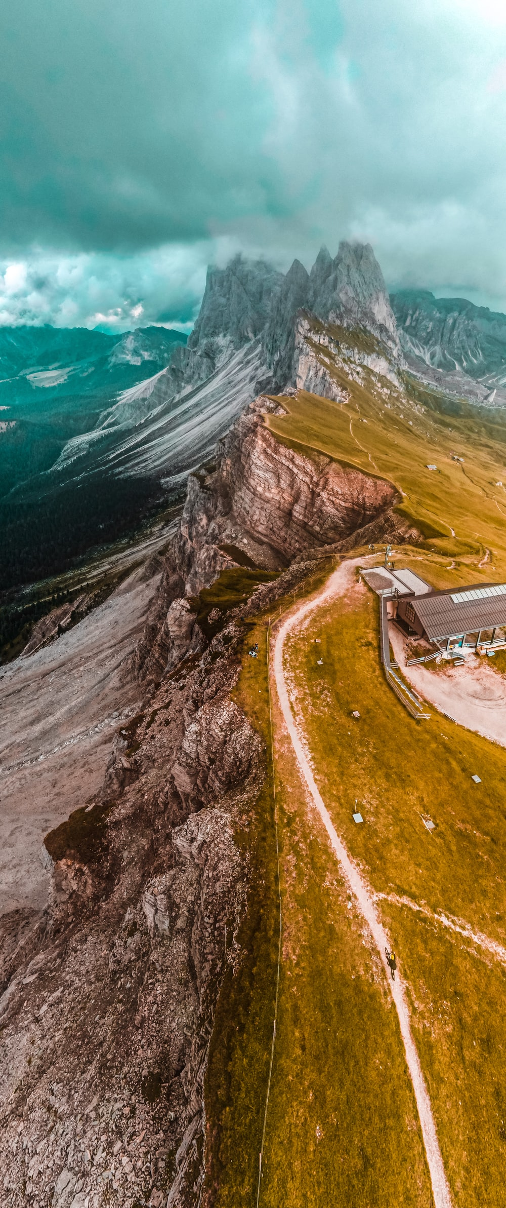 aerial view of house on cliff near body of water during daytime