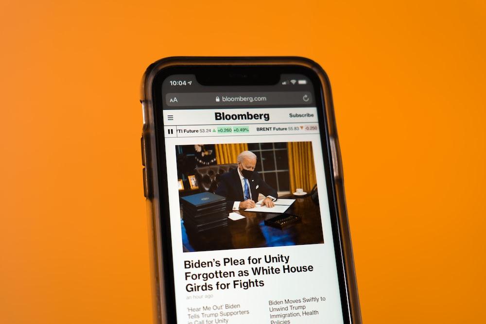 black samsung android smartphone on orange table