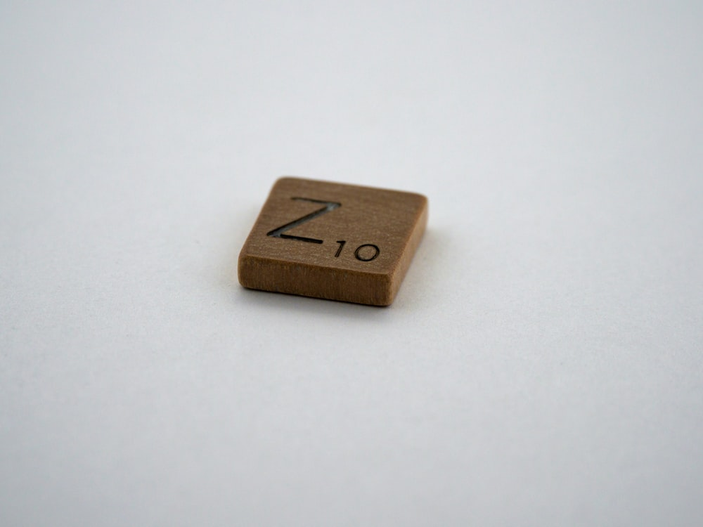 brown wooden cube on white table