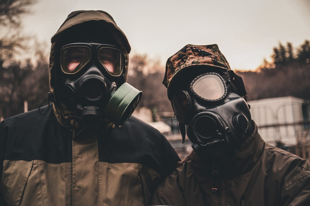 grayscale photo of person wearing gas mask
