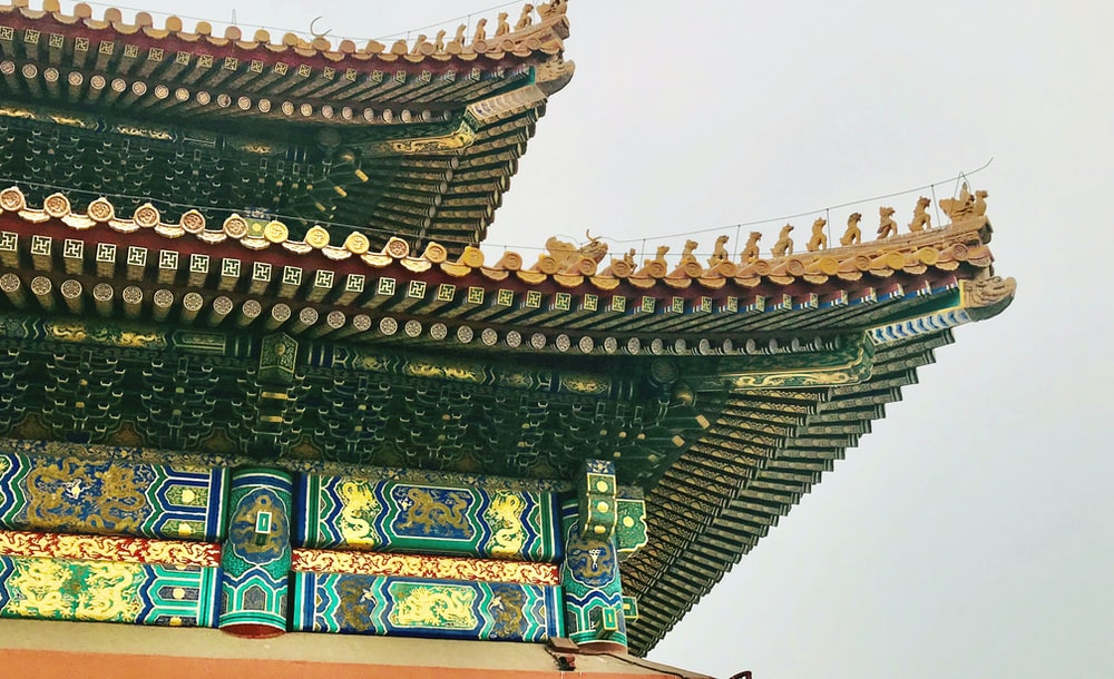 brown and green temple under white sky during daytime