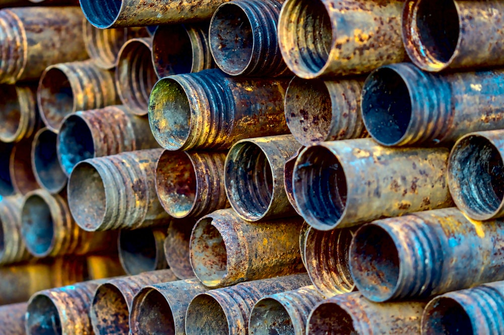 brown wooden tree logs in close up photography