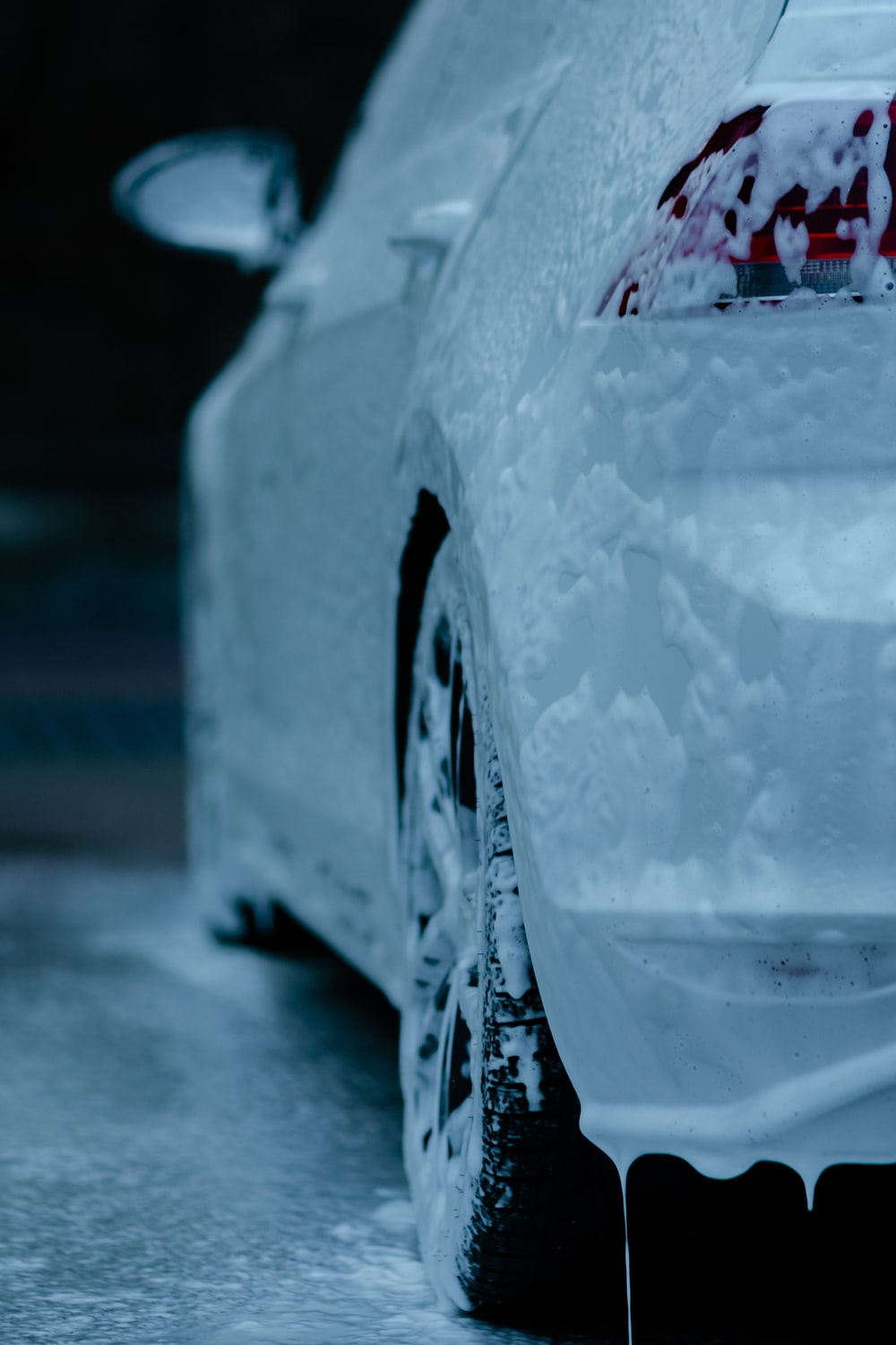 white car with water droplets