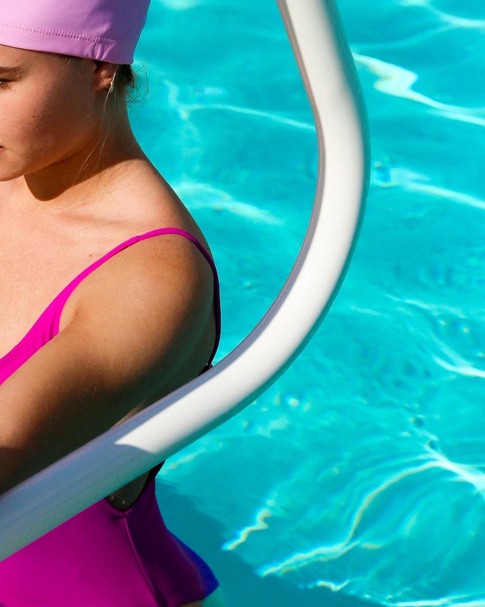 woman in pink bikini top in pool