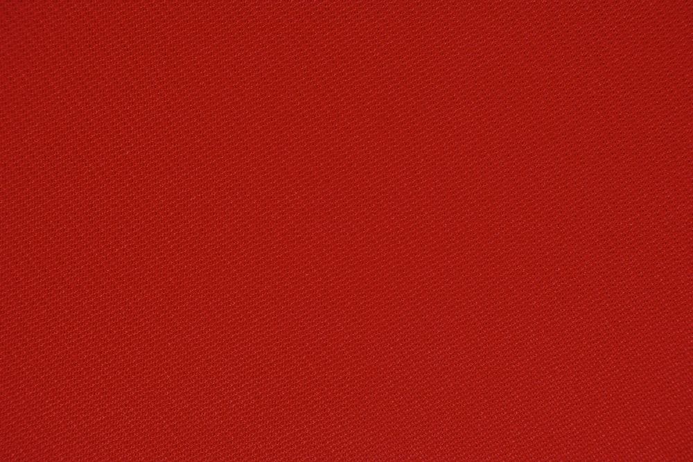 red textile in close up photography