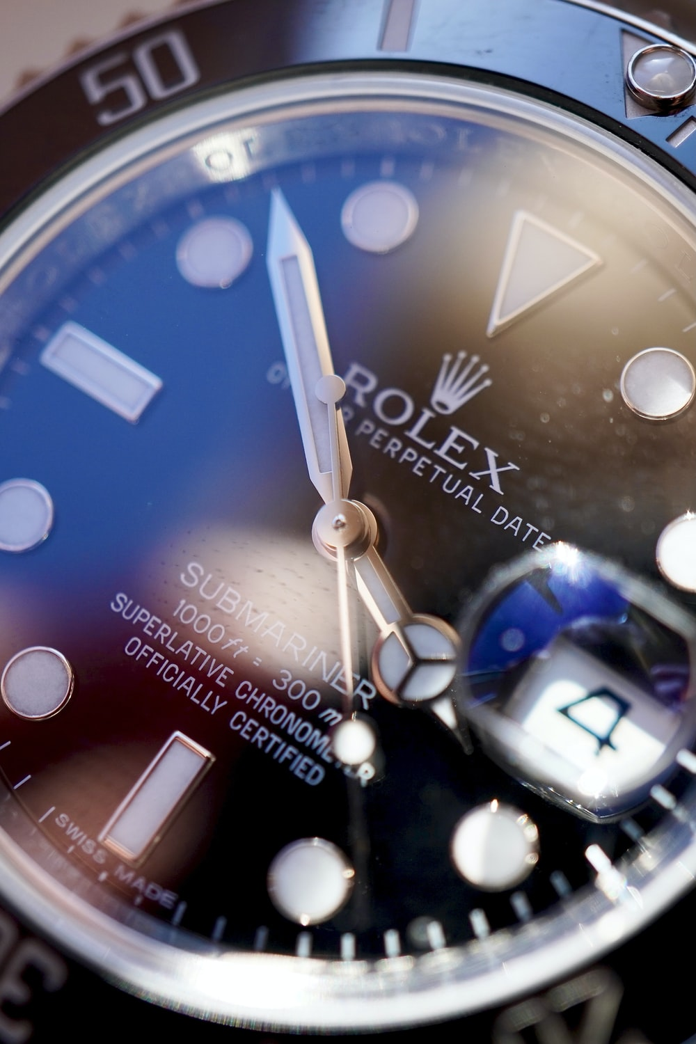 blue and silver round analog watch