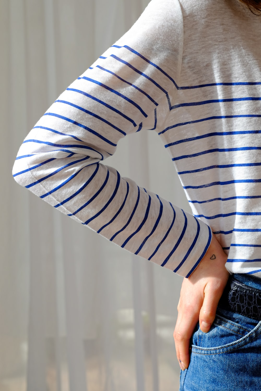 person in white and gray striped long sleeve shirt