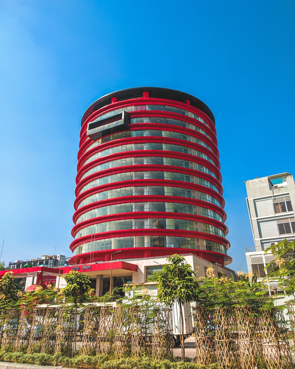 red and white concrete building during daytime