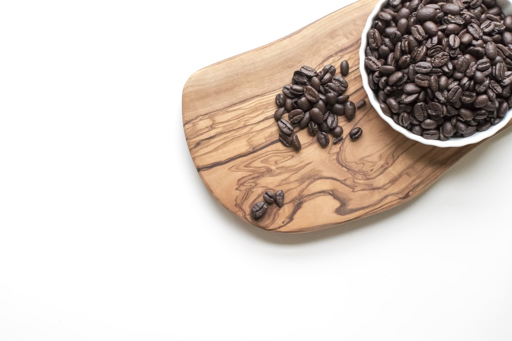 black beans on brown wooden chopping board