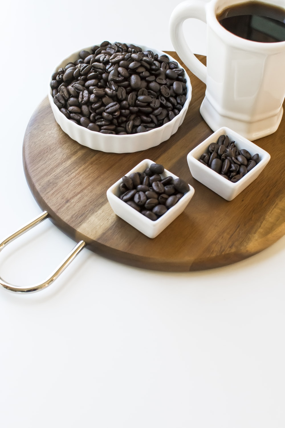 black and white ceramic mugs on brown wooden table