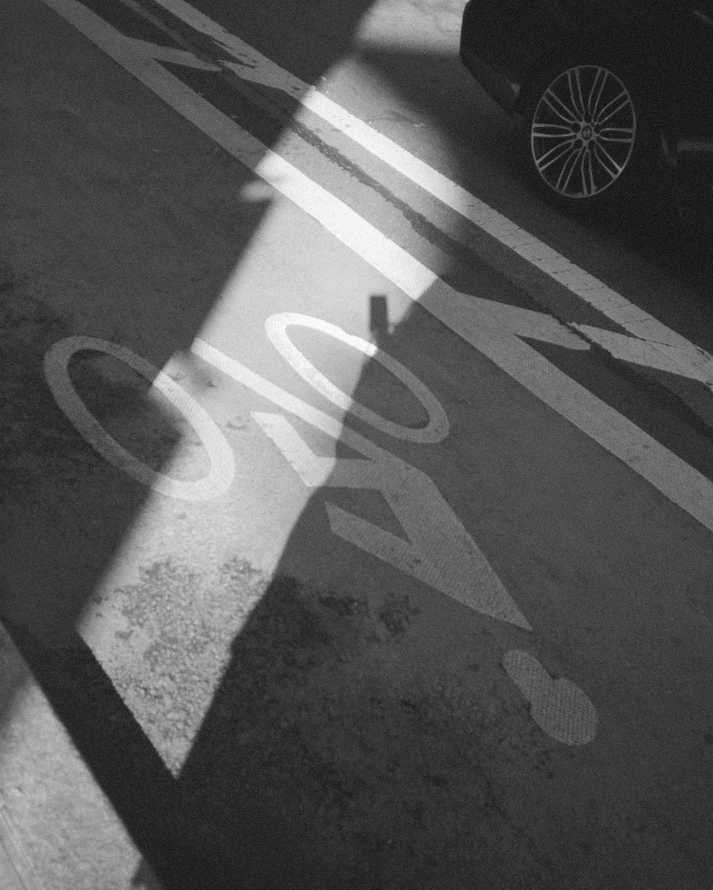shadow of a person on a road