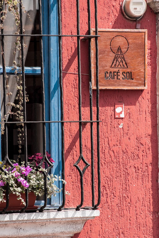 purple flowers on brown wooden door
