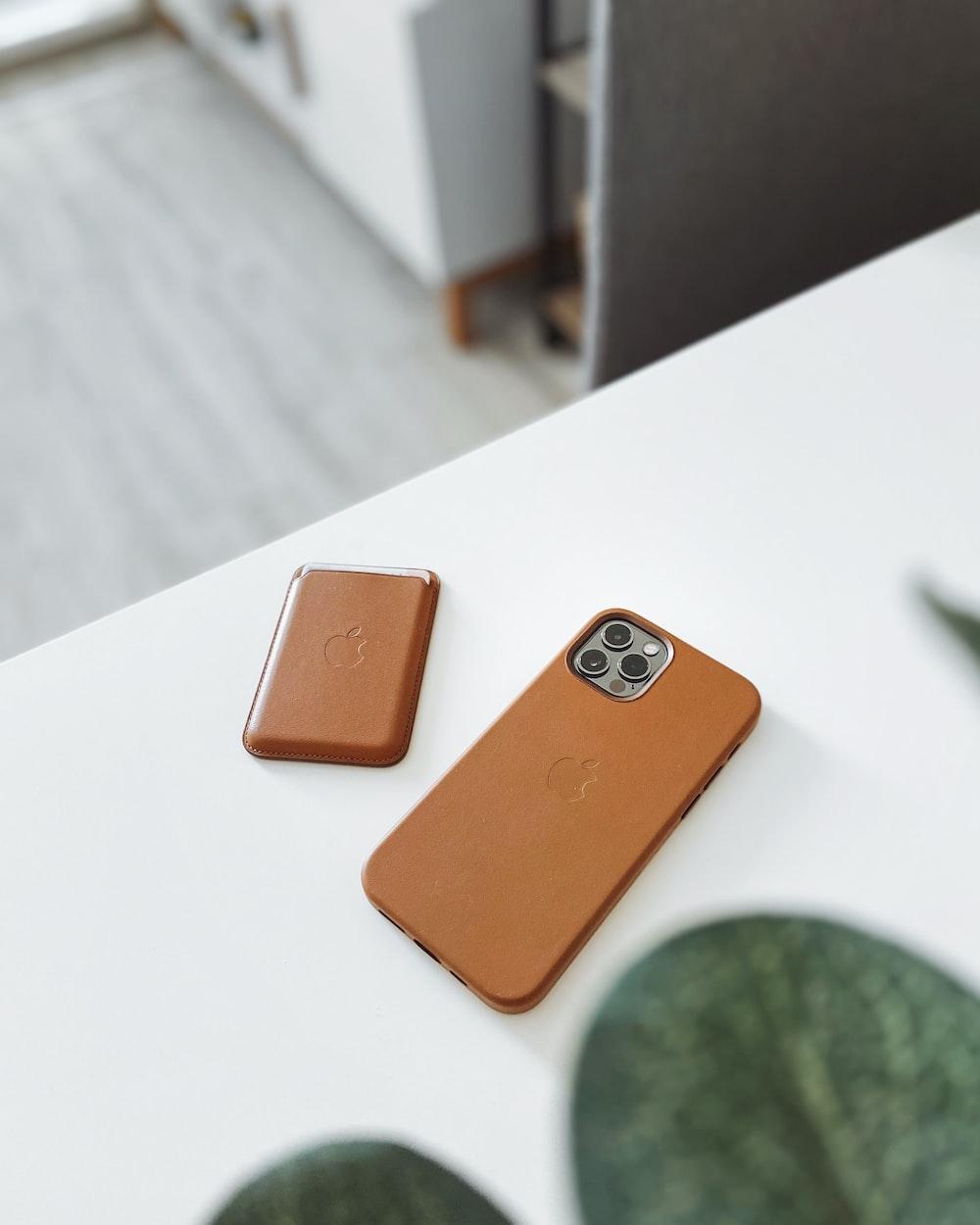 orange iphone case on white table
