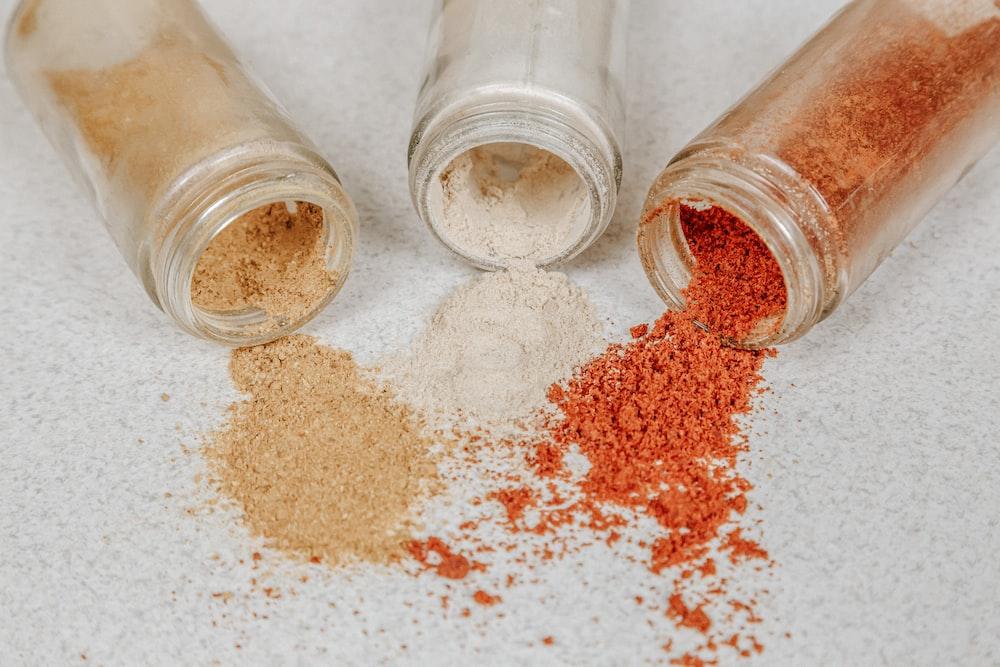 brown powder in clear glass jar