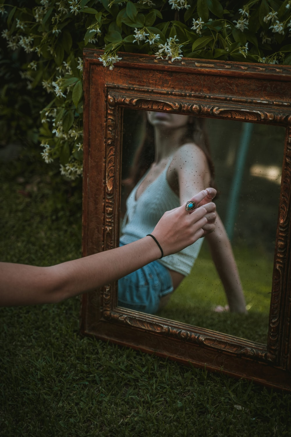 person holding brown wooden frame