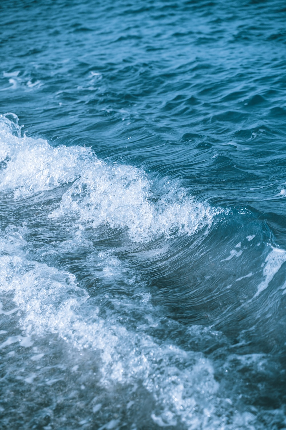 water waves on blue sea during daytime