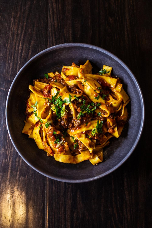 pasta dish on black ceramic bowl