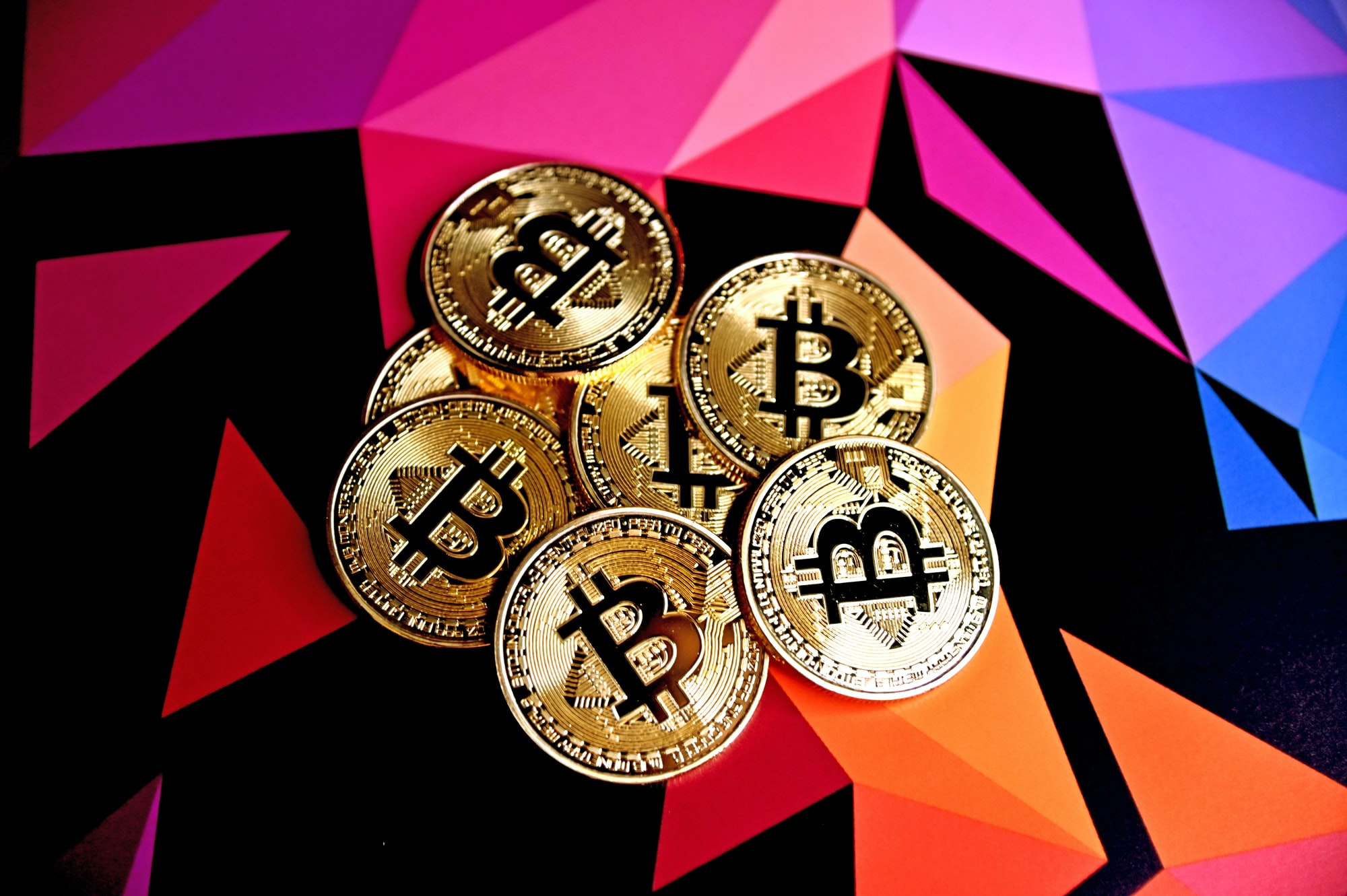 Bitcoins on a multi-colored background.