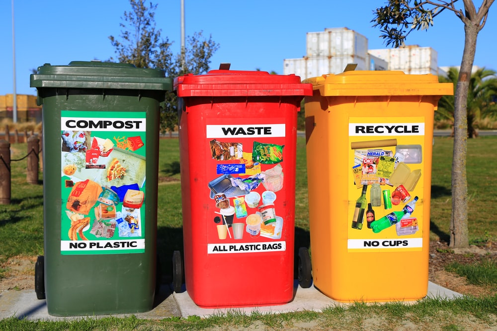 red yellow and green trash bins