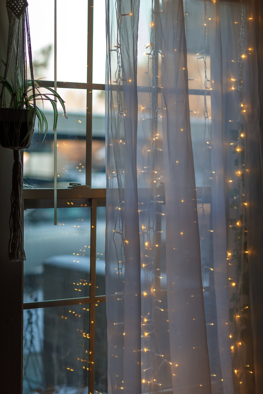 white and blue window curtain