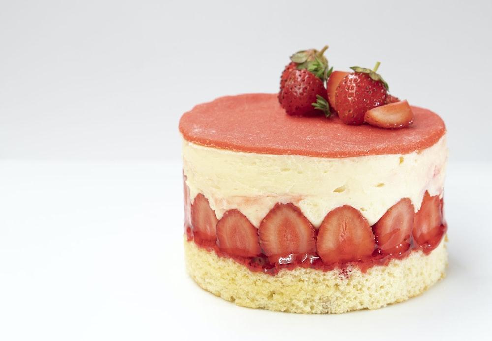 strawberry cake on white surface