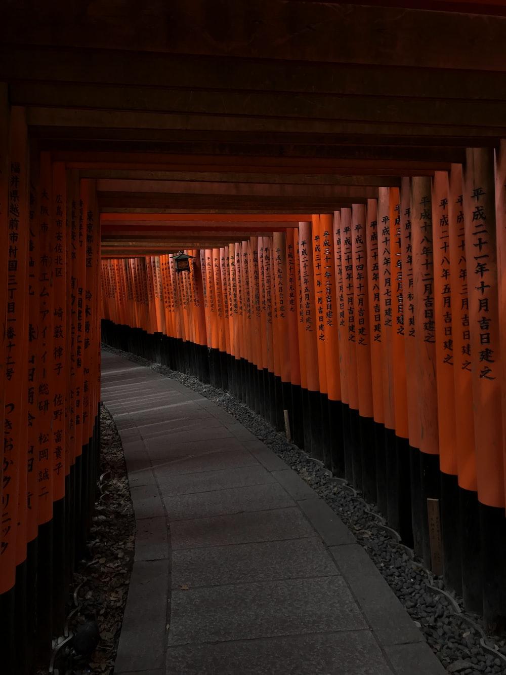 orange and black wooden posts