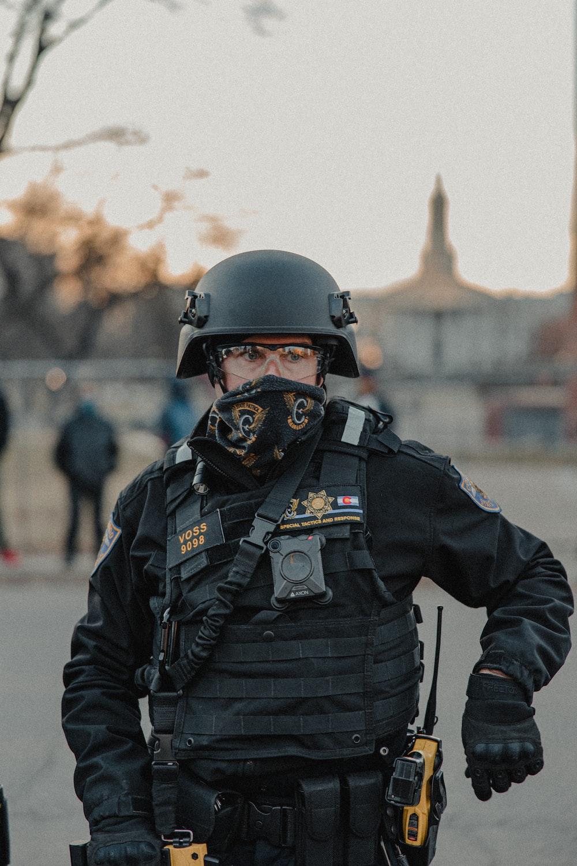 man in black police uniform wearing helmet