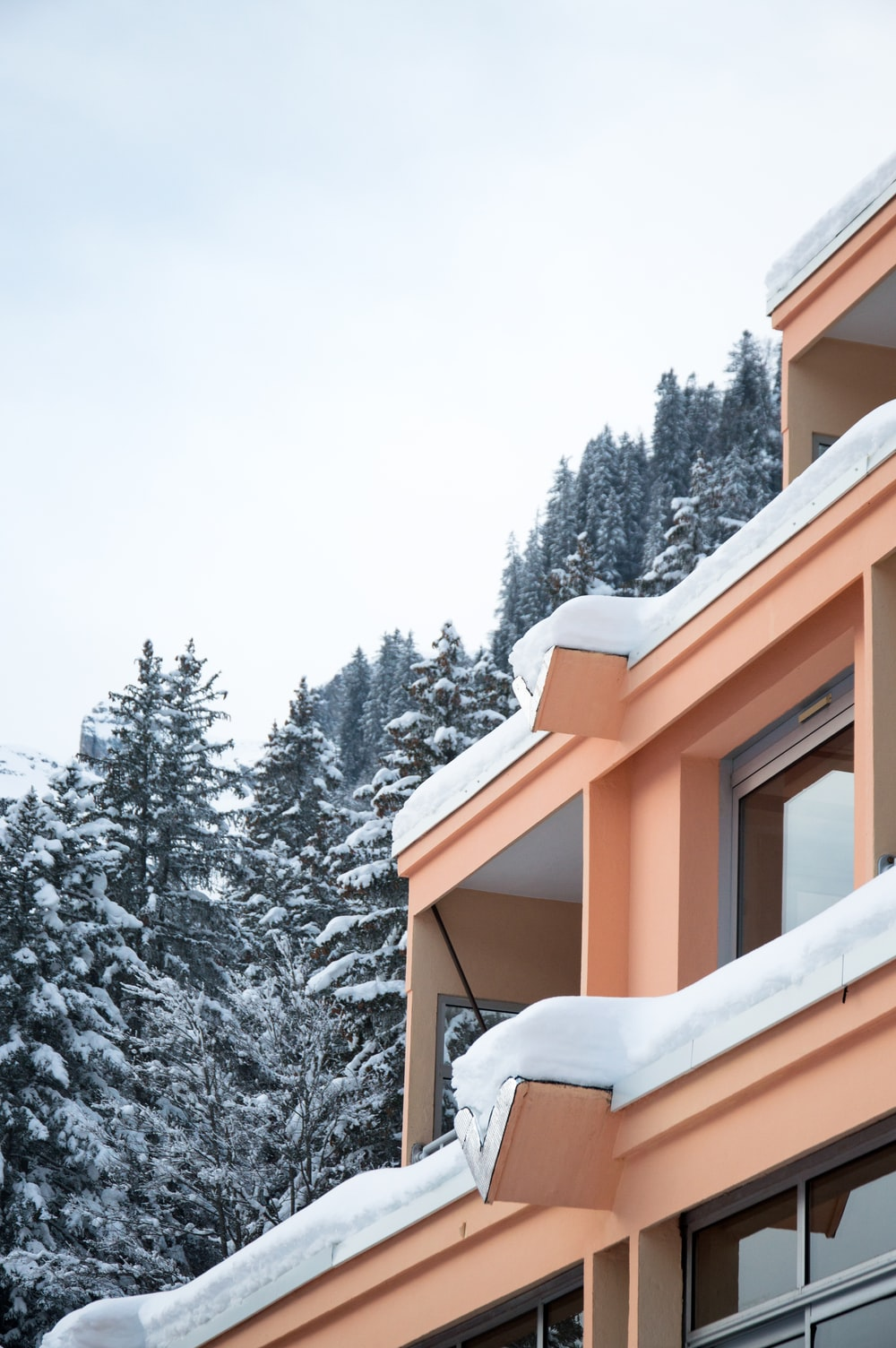 brown concrete building covered with snow