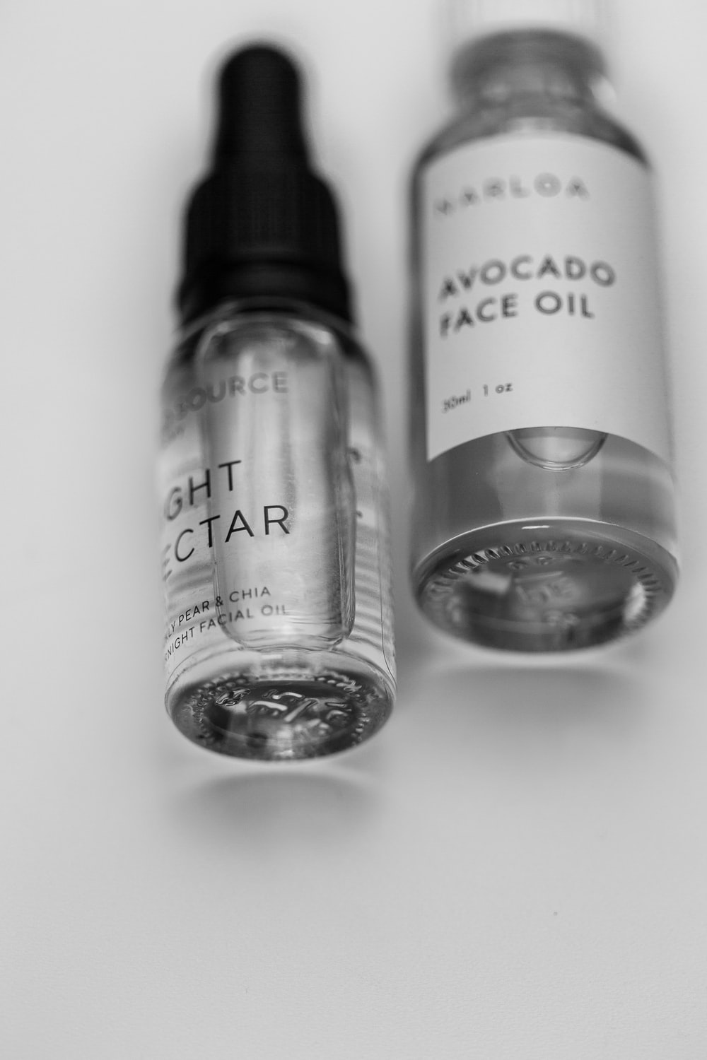 grayscale photo of 3 bottles
