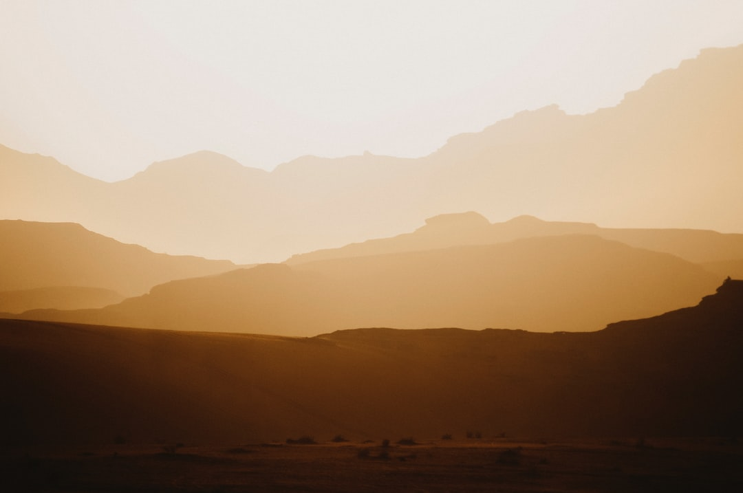 Silhouette of Mountains During Daytime - unsplash