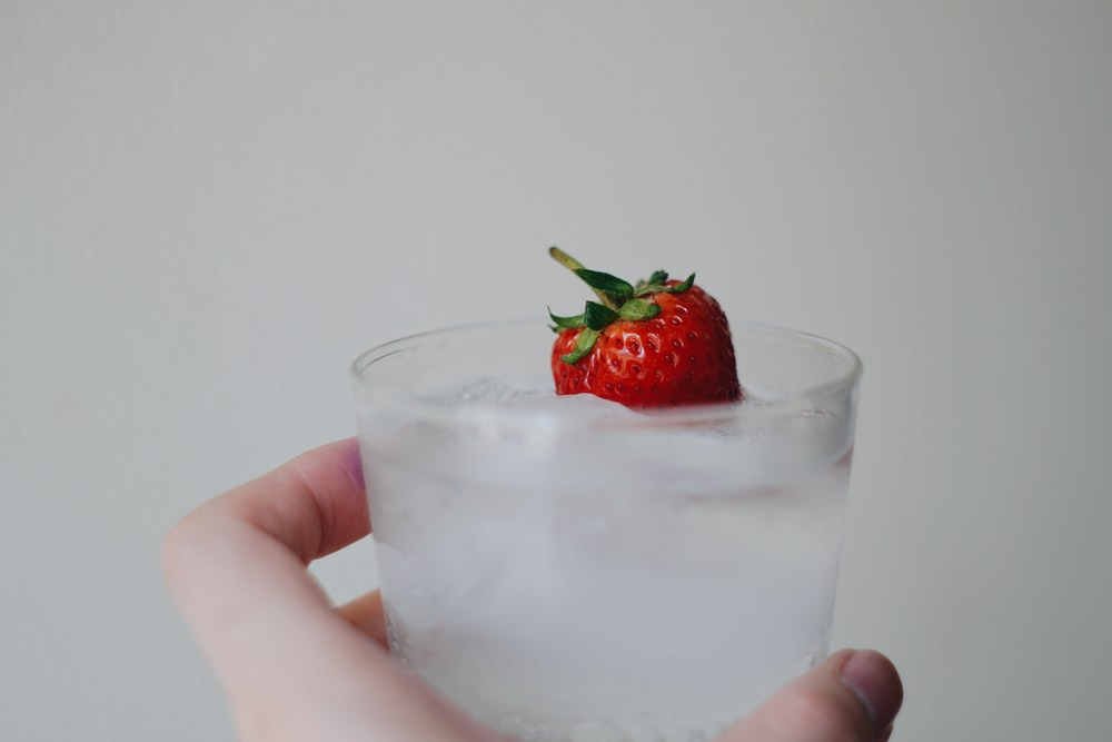 strawberry in clear drinking glass