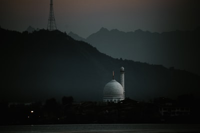 Srinagar white dome building on top of mountain during foggy day