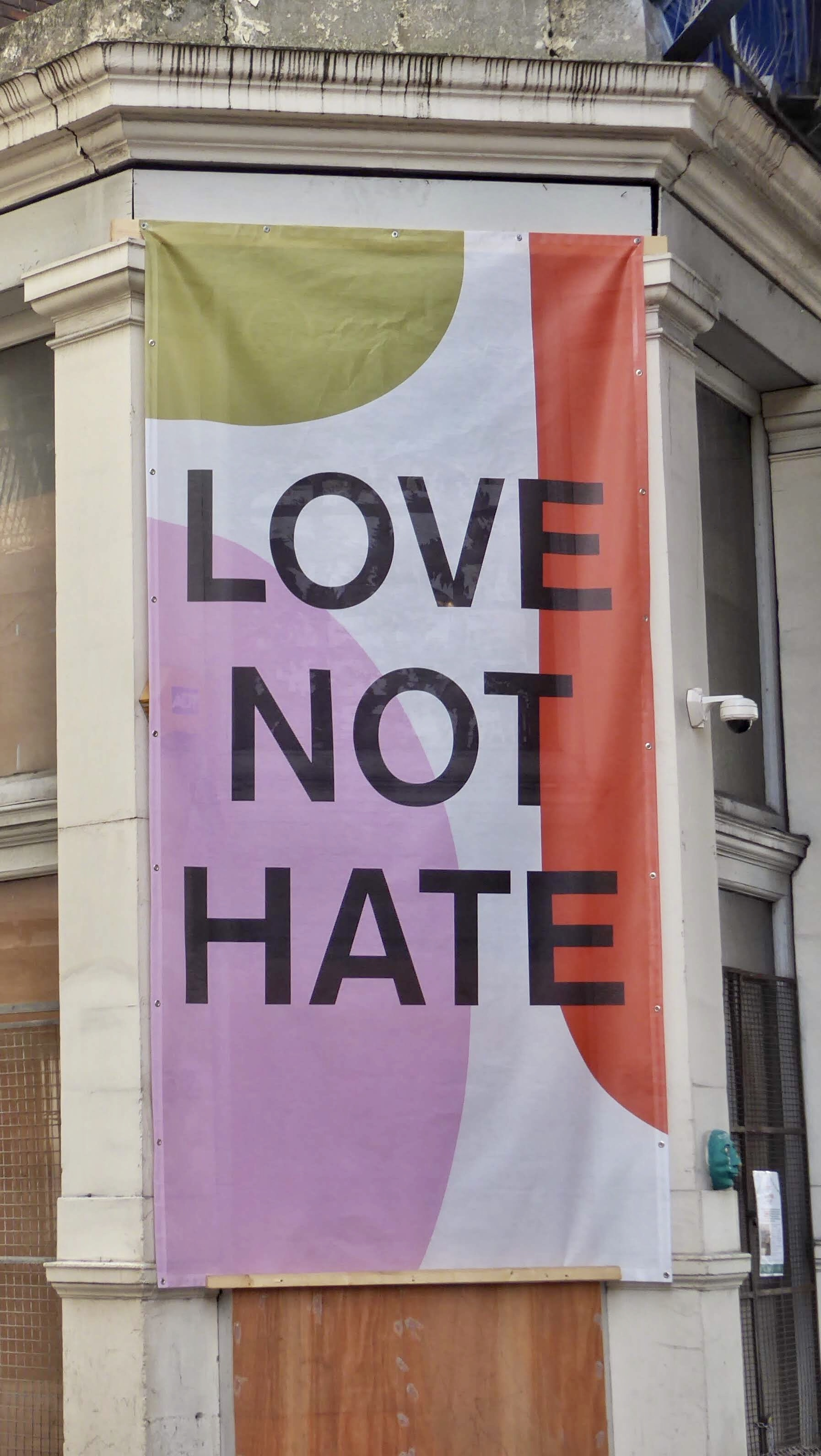 Walking along a London Street. The message. Love not Hate. Let's hope so.