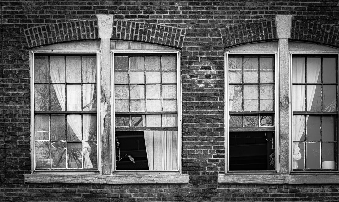 Grayscale Photo of Brick Building - unsplash