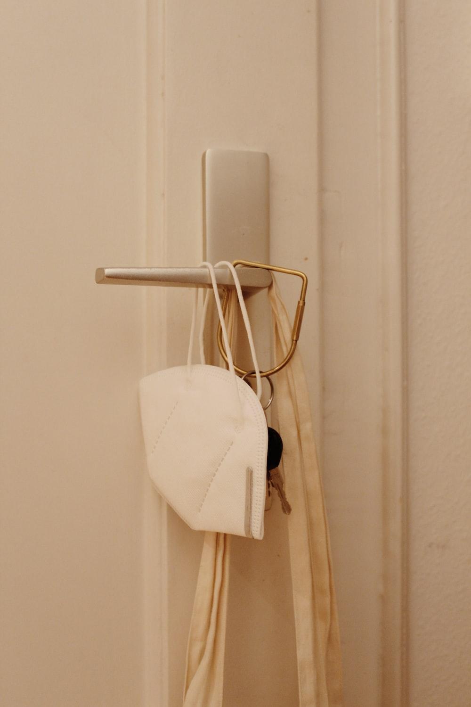 white towel on white metal rack