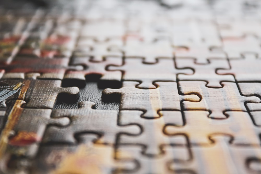 brown and black jigsaw puzzle